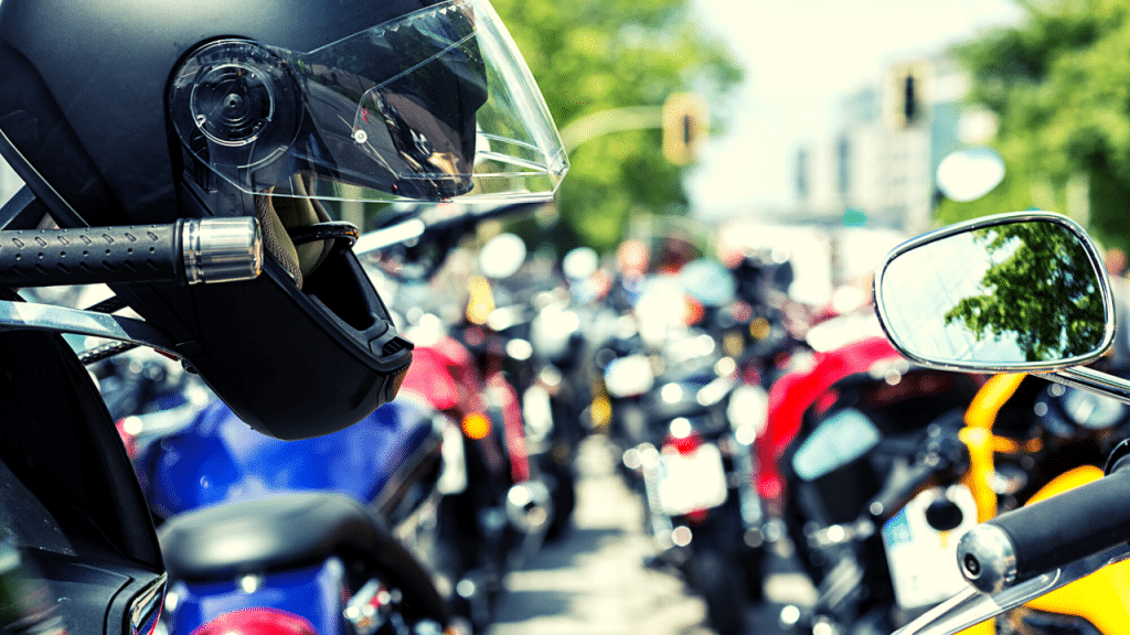 What do motorcycle helmet laws do and how effective are they?